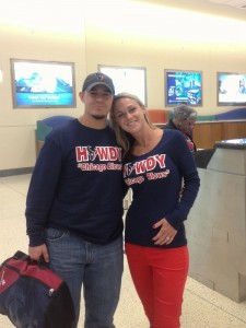 Barret and Desiree Ortega show off their sweatshirts before heading to Chicago