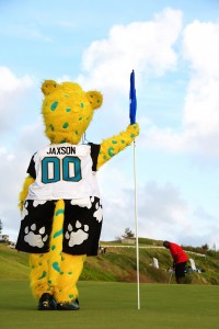 Jaxson playing caddy for Lawrence Taylor, who won the Bermuda Golf Classic (photo: D'Lamina Photography)
